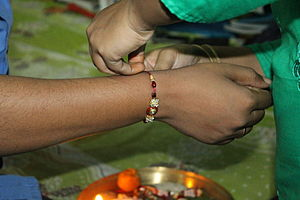 Raksha Bandhan - A rakhi being tied during Raksha Bandhan