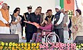 "Ram Nath Kovind distributing the Aids and Assistive devices to Divayagjan and Senior Citizen, at a function of the Declaration the Gwalior as ""Divyang Friendly District"", organised by Red Cross Society, Haryana Chapter.jpg"