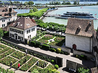 Einsiedlerhaus - Altstadt and harbour, Einsiedlerhaus and the rose garden, and, in the background, the wooden bridge (''Holzbrücke'') on ''Obersee'' and the Seedamm isthmus, as seen from the ''Lindenhof'' hill towards the castle (''Schloss'').
