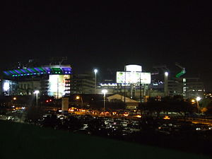 Super Bowl XLIII - Raymond James Stadium with Super Bowl XLIII decorations and colored lights viewed from nearby parking lot roof.