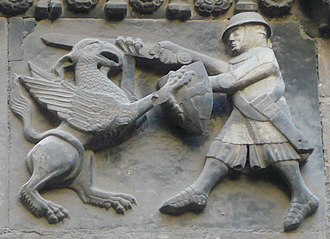 History of Barcelona - Neo-Gothic stone relief on façade of Porta de Sant Iu, Cathedral of Barcelona.