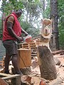 Right Mukore carving a tree into a woman lifting a heart at Montebello Bibiloucapetown Essay Photo x10 IMG 1010.jpg
