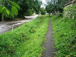 River Lambourn - River Lambourn between road and pavement, Upper Lambourn, Berkshire