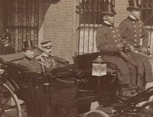 Embassy of Germany, Washington, D.C. - Theodore Roosevelt and aide de camp Col. Bingham depart the chancery of the German embassy in the presidential state coach following a return visit to Prince Henry of Prussia in 1902.