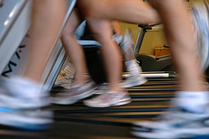 English: Lower legs of several people running ...