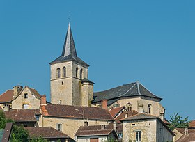 Saint-Andeol Church towering over town of Parisot.jpg