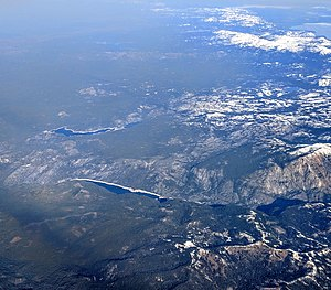 Bear River Dam - The Salt Springs Reservoir (below), Lower Bear River Reservoir (above left), and Bear River Reservoir (above center) are visible in aerial view from the south, with Mokelumne Peak in the Mokelumne Wilderness at the far right. A portion of Lake Tahoe is visible at the upper right.