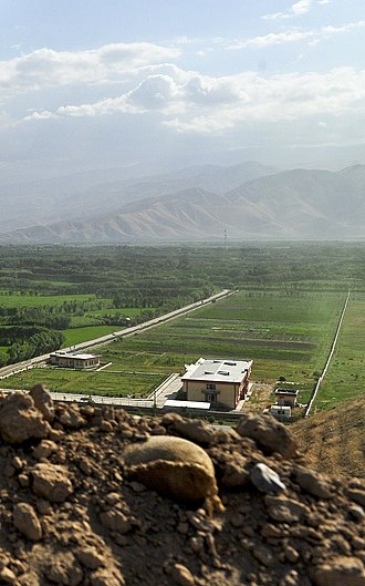 Samangan Province - Flat agricultural fields with mountains in the background