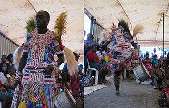 Rhythm in Sub-Saharan Africa - Traditional healer (sangoma) of South Africa dancing to the rhythm of the drum in celebration of his ancestors