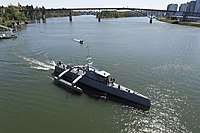 Sea Hunter gets underway on the Willamette River following a christening ceremony in Portland, Ore. (25702146834).jpg