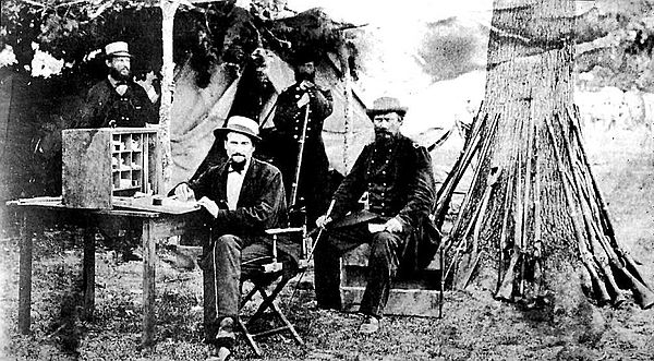 Group of 6th U.S. Cavalry officers in camp at Snickers Gap, Va., in 1862, standing, left to right, 2nd Lt. Thos. W. Simson, 1st Lt. Albert Coats. Sitting, left to right, 2nd Lt. Samuel Whitside, Captain August Kautz.[3]
