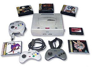 A Japanese Sega Saturn unit, with games and a controller