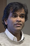 Sendhil Mullainathan - Behavioral Economics of Extreme Poverty - 2014 (13927918920) (cropped).jpg