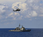 Sikorsky Multi-role helicopter and USS Normandy during Malabar 2015.jpg
