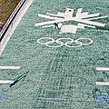 Skier lands at Utah Olympic Park Ski Jump during summer training session.jpg