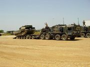 Heavy tractor trailer Elefant whilst loading a Leopard 2A4