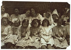 Some of the young girls who roll cigarettes in the Danville (Va.) Cigarette Factory.jpg