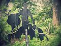 Statue in front of Thenmala park.jpg