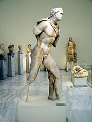 Statue of a youth wearing a chlamys