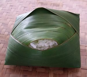 Banana leaf - Steamed rice wrapped inside banana leaf to enhance its aroma and aesthetic