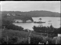 Stewart Island. View of the wharf at Oban, with Presbyterian Church on hill above, the SS Theresa Ward berthed at the wharf, and part of Half Moon Bay. ATLIB 273991.png