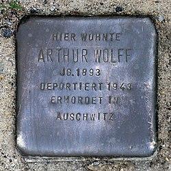 Photo of Arthur Wolff brass plaque