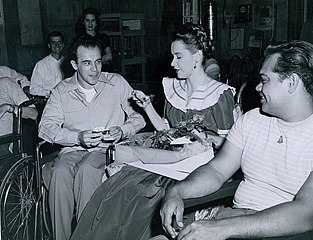 Peters being visited by the Paralyzed Veterans Association on set of The Sign of the Ram (1948)