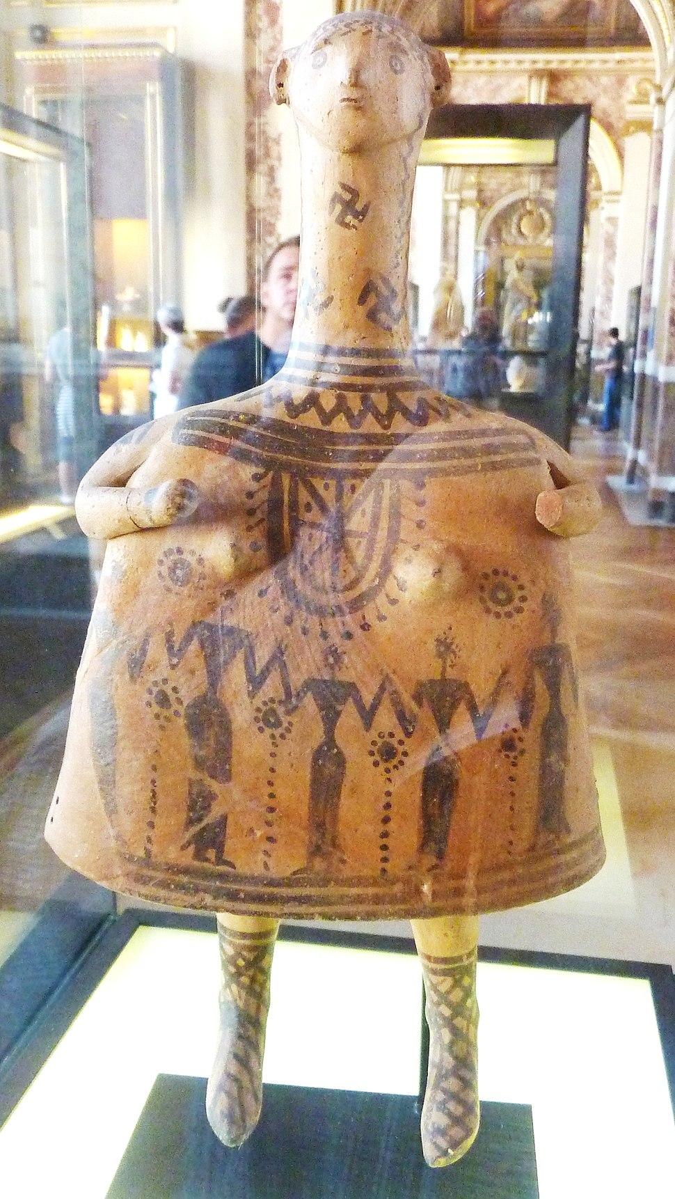 Swastika symbol in ancient greek doll
