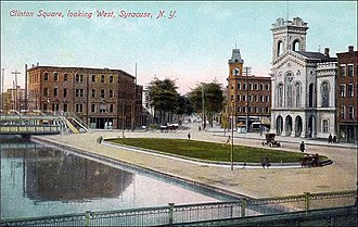 Downtown Syracuse - Clinton Square looking west in Syracuse, New York in 1909 with Erie Canal in forefront - Bastable Block in rear and old County Courthouse to right