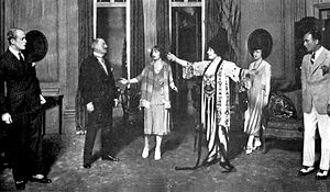 The Circle (play) - 1921 Broadway cast, L-R: Robert Rendel, John Drew, Estelle Winwood, Mrs. Leslie Carter, Maxine MacDonald, and John Halliday