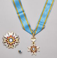 The Order of the Sacred Treasure, Gold and Silver Star.png