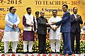 The President, Shri Pranab Mukherjee presenting the National Award for Teachers-2015 to Shri Patel Dineshchandra Govind (Daman & Deu), on the occasion of the 'Teachers Day', in New Delhi.jpg