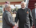 The Prime Minister, Shri Narendra Modi being received by the Acting Prime Minister of Jordan, Dr. Mamdouh Al Abbadi, on his arrival, at Queen Alia International Airport, in Amman, Jordan on February 09, 2018.jpg