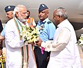 The Prime Minister, Shri Narendra Modi being welcomed by the Governor of Rajasthan, Shri Kalyan Singh, on his arrival, at Jaisalmer Air base, in Rajasthan on March 18, 2016.jpg