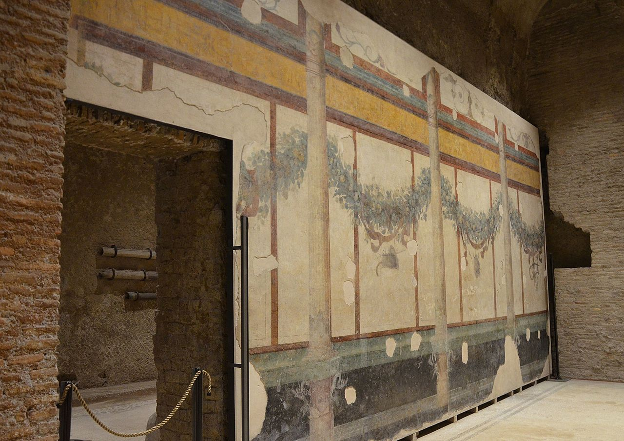 The right-hand room of the House of Livia, characterized by luxuriant festoons and garlands of fruits, flowers, branches and leaves, House of Livia, Palatine Hill, Rome (20895830309).jpg