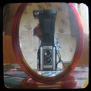 Through the Viewfinder photography - Set-up for through the viewfinder photography. The photograph is taken by a digital camera, top, through the viewfinder of a Kodak Duaflex box camera. The two cameras are linked by a cardboard tube to block out excess light and avoid reflections from the Duaflex glass.