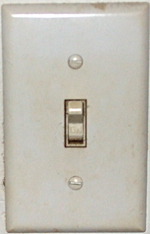 A toggle light switch.