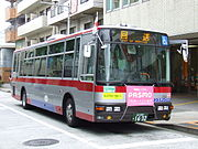 A bus displaying the flag of Japan
