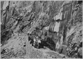 Tourist party with guide at Hanging Gardens on the Narrows Trail. - NARA - 520539.tif