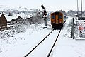 Train from Merthyr Tydfill at Abercynon Station - Snow January 2013.jpg