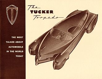 Tucker 48 - Tucker Torpedo brochure, c. 1947. This concept drawing includes a centrally positioned steering wheel, doors that wrap up into the roof, and front fenders that turn when the car is cornering. These features did not reach production.