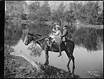 Two children on a pony riding to school (4903871598).jpg