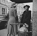 Two women talk at corner of High and Dwight, Holyoke, Massachusetts (1941).jpg