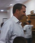 A picture of Ty Detmer wearing a button down.