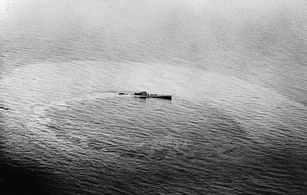 "U-459, a Type XIV supply submarine (known as a ""milch cow"") sinking after being attacked by a Vickers Wellington U-boat Warfare 1939-1945 C3780.jpg"