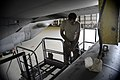 U.S. Air Force Senior Airman Jason Panian, an electronic warfare systems journeyman with the 41st Expeditionary Electronic Combat Squadron, performs maintenance on an EC-130H Compass Call aircraft Aug. 25, 2014 140825-F-PB969-083.jpg
