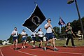 U.S. Airmen carry a POW-MIA flag, center, and a unit guidon during the POW-MIA Vigil Run, a 24-hour run in observance of National POW-MIA Recognition Day, at Joint Base Andrews, Md., Sept 130919-F-HB697-062.jpg