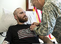 U.S. Army Gen. John F. Campbell, right, the vice chief of staff of the Army, pins a Purple Heart on Staff Sgt. Cody Ensley at the San Antonio Military Medical Center at Joint Base San Antonio-Fort Sam Houston 140103-A-JW984-020.jpg