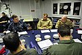 U.S. Navy Cmdr. Andrew Biehn, center left, the commanding officer of the guided missile destroyer USS Truxtun (DDG 103), discusses future Black Sea training exercises with Romanian naval officers in Varna 140315-N-AL577-027.jpg