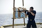 U.S. Navy Gunner's Mate 3rd Class Colby Perry fires an M14 rifle during a small-arms qualification June 10, 2013, aboard the guided missile cruiser USS Monterey (CG 61) while underway in the Persian Gulf 130610-N-QL471-314.jpg